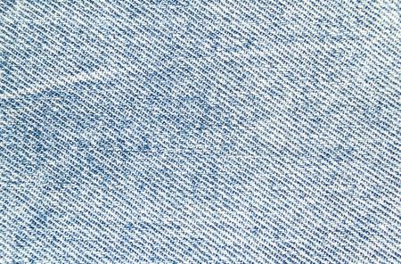 Closeup light blue jeans denim textile texture background. Imagens