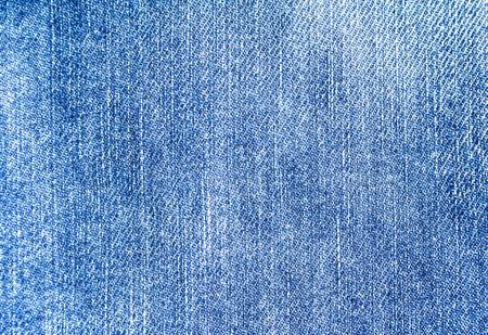 Closeup classic blue jeans denim fabric texture background.