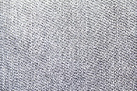 Closeup grijze jeans denim textiel textuur achtergrond. Stockfoto