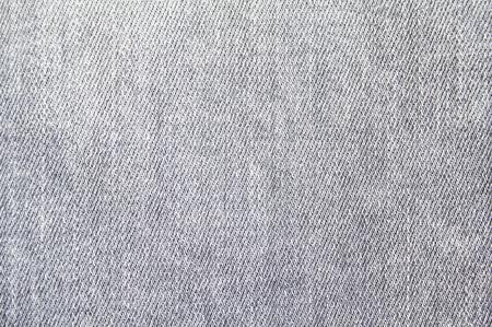 Gros plan de fond de texture textile denim jeans gris. Banque d'images