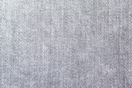 Closeup grey jeans denim fabric texture background.