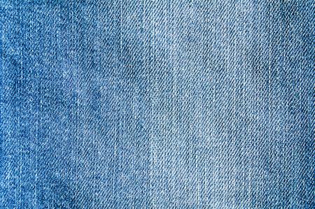 Closeup classic blue jeans fabric texture background.
