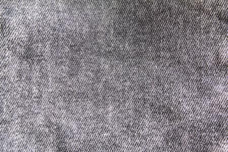 Closeup grey shabby jeans denim fabric texture background.