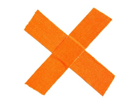 Bright orange matte cloth gaffer tape cross isolated on white background.
