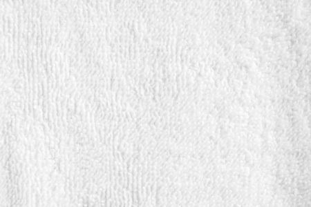 Closeup white blank fluffy terry towel texture background. Imagens