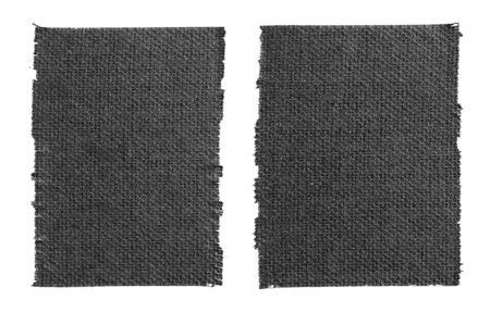 Closeup two pieces of black matte cloth gaffer tape isolated on white background. Can be used for text.