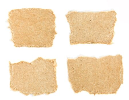 Set of small torn pieces of cardboard paper on white background. Can be used for text.