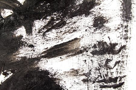 Black acrylic brush strokes and scribble on white background. Abstract grunge handmade drawing.