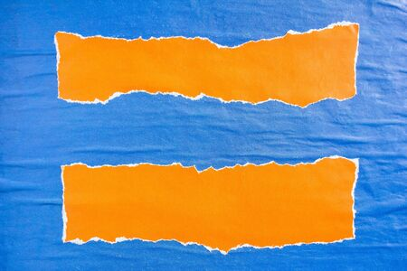 Blue and orange crumpled torn gloss paper posters and placards glued on billboard with rough surface texture background. Can be used for text.
