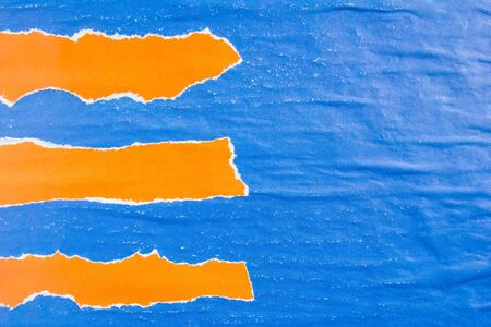 Blue and orange crumpled torn gloss shabby paper posters with rough surface texture background. Can be used for text.