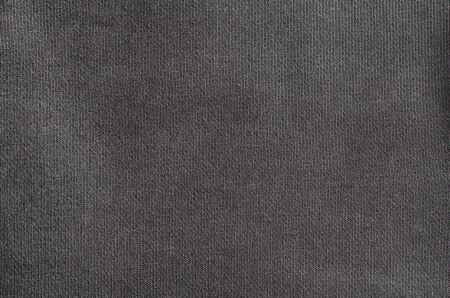 Nahaufnahme schwarzer leerer Baumwolltextilbeschaffenheitshintergrund. Standard-Bild