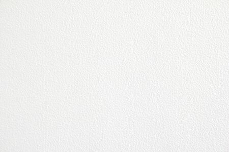 Closeup white paper with rough surface texture background. Looks like white plastered wall. Banco de Imagens