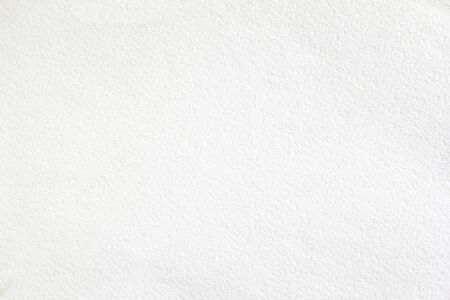 White sheet of thick drawing paper with rough surface texture background. Banco de Imagens