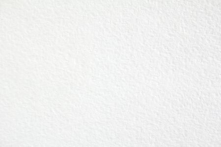 Closeup white sheet of thick drawing paper with rough surface texture background.