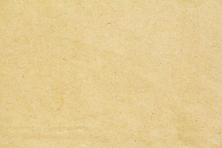 Closeup brown beige sheet of wrapping paper texture background. Can be used for text.