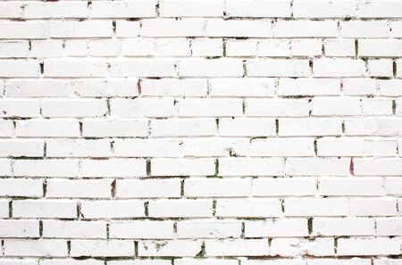 Old white painted brick wall texture background. Banco de Imagens