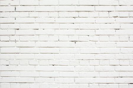 Dirty white painted brick wall texture background. Banco de Imagens