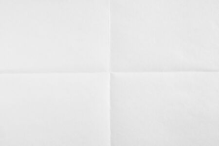 White blank sheet of paper folded in four. White crumpled paper texture background.
