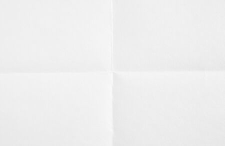 Closeup white blank sheet of paper folded in four. White crumpled paper texture background. Banco de Imagens