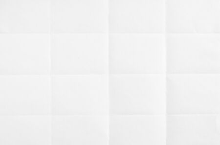 White blank folded sheet of paper. White crumpled paper texture background.