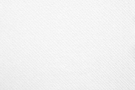 Closeup white blank paper napkin with rough surface texture background. Banco de Imagens