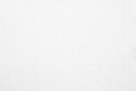 Weiße leere Papierserviette der Nahaufnahme mit rauem Oberflächenbeschaffenheitshintergrund.