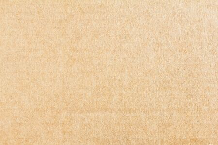 Brown blank cardboard paper sheet texture background. Banco de Imagens