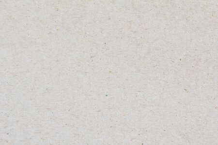 Closeup grey sheet of craft cardboard paper texture background. Banco de Imagens