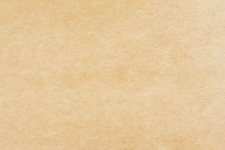 Closeup brown sheet of craft cardboard paper texture background. Horizontal image.