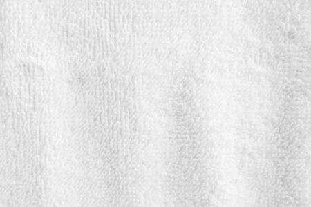 Closeup white crumpled soft terry towel texture background.