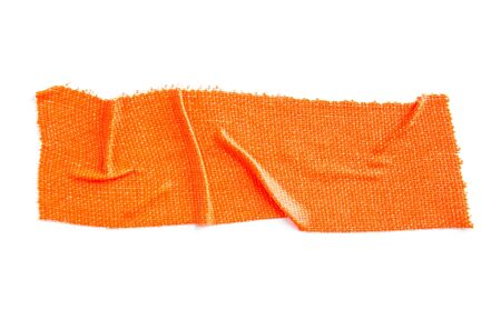 Crumpled piece of orange matte cloth gaffer tape isolated on white background. Standard-Bild
