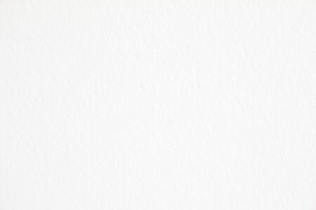 Closeup white blank thick paper texture background. Banco de Imagens