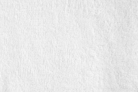 Closeup white blank soft terry towel texture background. Banco de Imagens