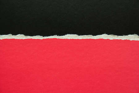 Red and black torn sheet of cardboard paper texture background. Can be used for text message.