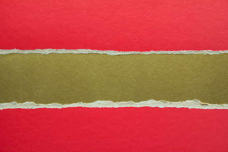 Red and golden torn and ripped sheet of cardboard paper texture background. Can be used for text message.