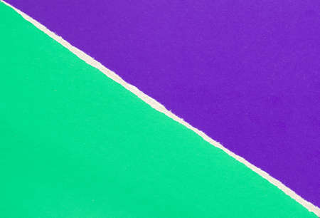 Green and purple violet torn sheet of cardboard paper with diagonal border texture background. Can be used for text.