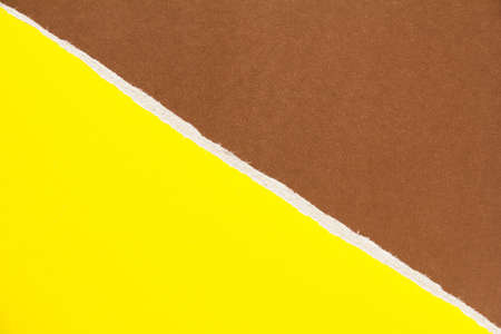 Yellow and brown torn sheet of cardboard paper with diagonal border texture background. Can be used for text. Stock fotó