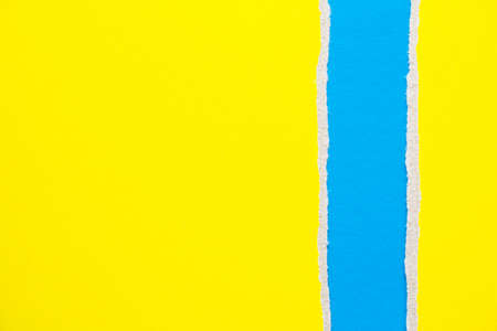 Blue and yellow torn and ripped cardboard paper texture background. Can be used for text.