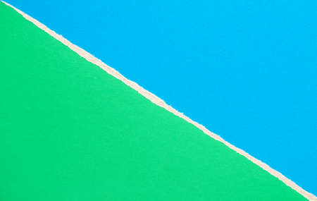 Green and blue torn sheet of cardboard paper with diagonal border texture background. Can be used for text.