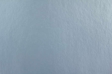 Closup silver gray sheet of cardboard paper with rough surface texture background.