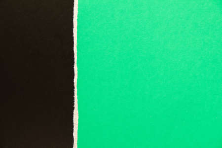 Black and green torn cardboard paper texture background. Can be used for text.