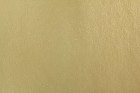 Closup golden sheet of cardboard paper with rough surface texture background. Stock fotó