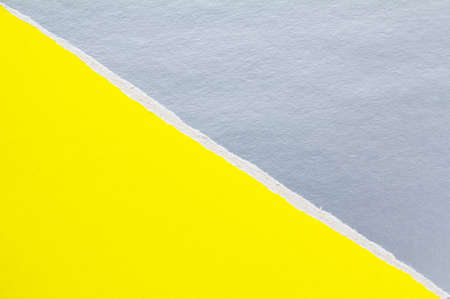 Yellow and silver gray torn sheet of cardboard paper with diagonal border texture background. Can be used for text.