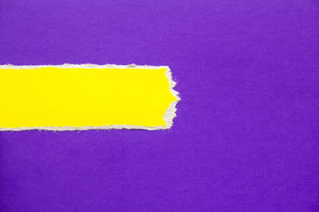 Purple cardboard paper with torn yellow horizontal stripe texture background. Can be used for text. Stock fotó