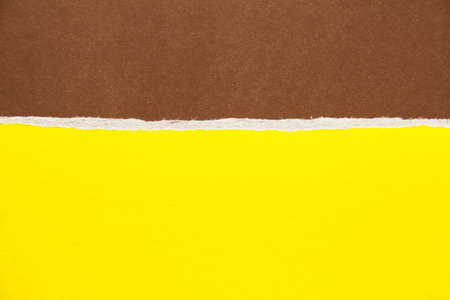 Brown and yellow torn sheet of cardboard paper texture background. Can be used for text message.