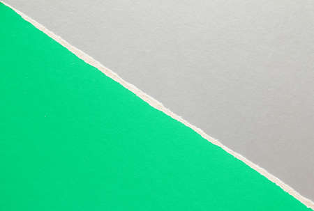 Green and silver gray torn sheet of cardboard paper with diagonal border texture background. Can be used for text.
