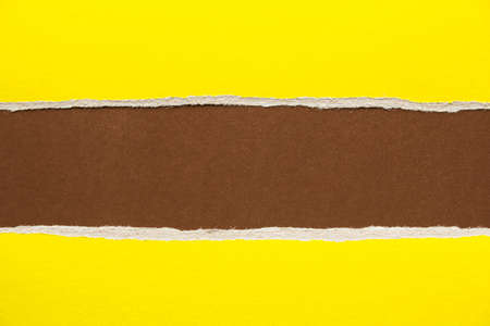Brown and yellow torn and ripped sheet of cardboard paper texture background. Can be used for text message. Stock fotó