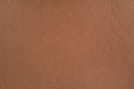 Closeup brown sheet of cardboard paper with rough surface texture background.