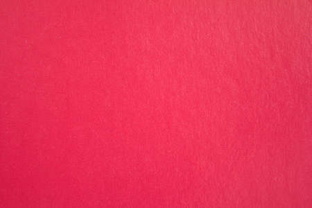 Closeup red sheet of cardboard paper with rough surface texture background.