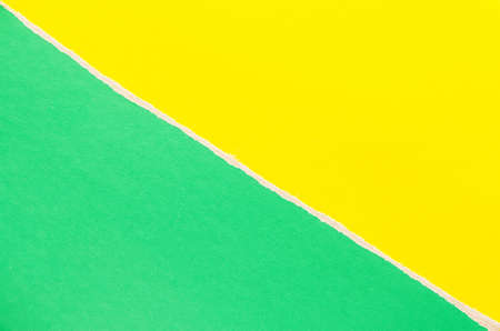 Green and yellow torn cardboard paper texture background. Can be used for text.